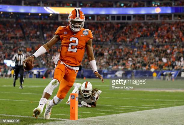 Kelly Bryant of the Clemson Tigers scores a touchdown against the Miami Hurricanes in the first quarter during the ACC Football Championship at Bank...