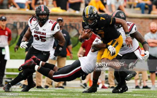 Kelly Bryant of the Missouri Tigers runs on a scramble into T.J. Brunson of the South Carolina Gamecocks in the second quarter at Faurot...