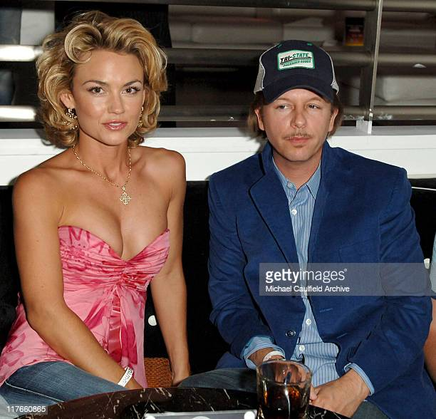 Kelly Carlson and David Spade during Maxim Magazine's Hot 100 Inside at The Day After in Hollywood California United States