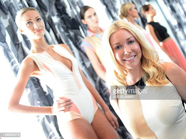 Kelly Carrington designer and founder of Eclairee swim wear poses with her models during the MerecedesBenz Fashion Week Swim 2013 at The Raleigh on...