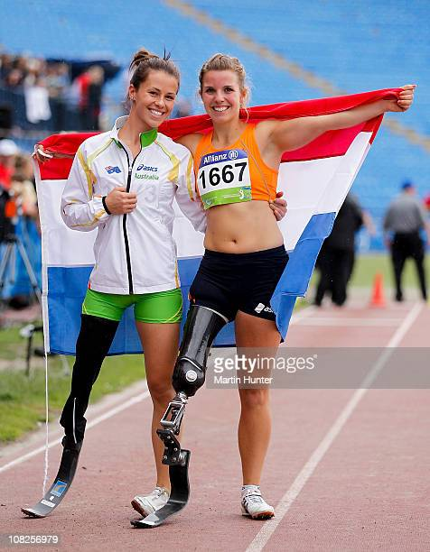 Kelly Cartwright of Australia and Marije Smits of Netherlands pose after competing in the Women's Long Jump F42 during the IPC Athletics World...