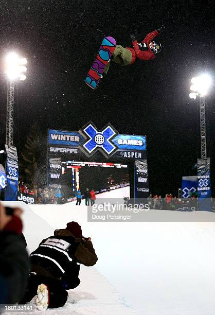 Kelly Clark spins above the halfpipe en route to winning the gold medal in the Women's Snowbaord Superpipe during Winter X Games Aspen 2013 at...