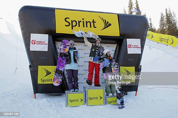 Kelly Clark takes the podium after winning the women's halfpipe finals along with Madeline Shaffrick in second place and Queralt Castellet of Spain...