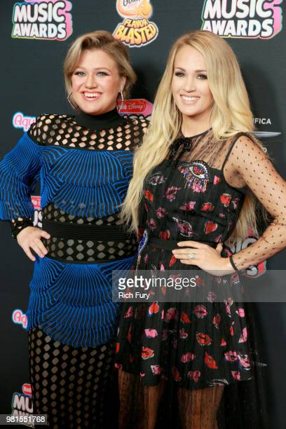 Kelly Clarkson and Carrie Undewood attend the 2018 Radio Disney Music Awards at Loews Hollywood Hotel on June 22 2018 in Hollywood California