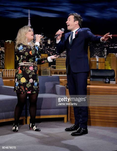 Kelly Clarkson and host Jimmy Fallon sign a duet during the 'Google Translates Songs' segment on 'The Tonight Show Starring Jimmy Fallon' at...