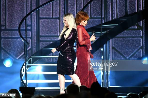 Kelly Clarkson and host Reba McEntire perform onstage during the 53rd Academy of Country Music Awards at MGM Grand Garden Arena on April 15 2018 in...