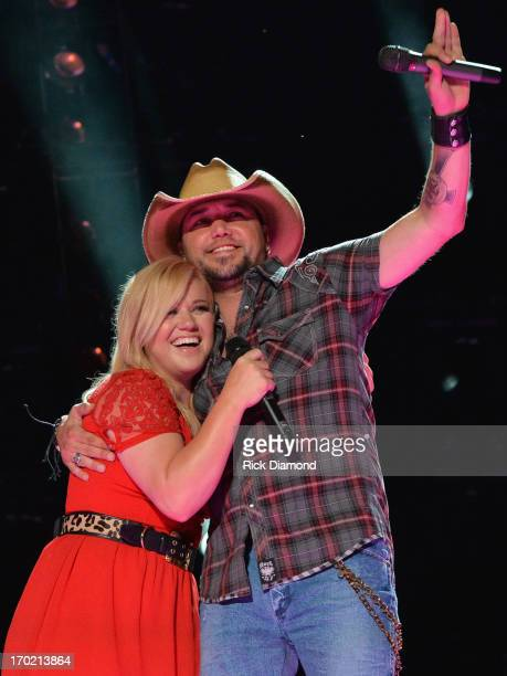 Kelly Clarkson and Jason Aldean perform during the 2013 CMA Music Festival on June 8 2013 at LP Field in Nashville Tennessee