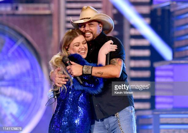 Kelly Clarkson and Jason Aldean perform onstage during the 54th Academy Of Country Music Awards at MGM Grand Garden Arena on April 07 2019 in Las...