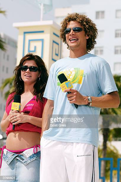 Kelly Clarkson and Justin Guarini appear during a taping for MTV Spring Break 2003 at the Surfcomber Hotel March 13 2003 in Miami Beach Florida