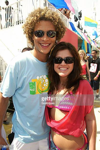 Kelly Clarkson and Justin Guarini pose for a photo backstage during a taping for MTV Spring Break 2003 at the Surfcomber Hotel March 13 2003 in Miami...
