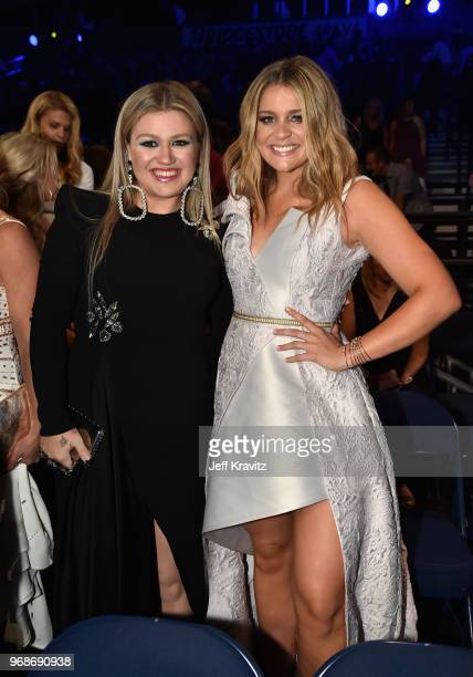 Kelly Clarkson and Lauren Alaina attend the 2018 CMT Music Awards at Bridgestone Arena on June 6 2018 in Nashville Tennessee