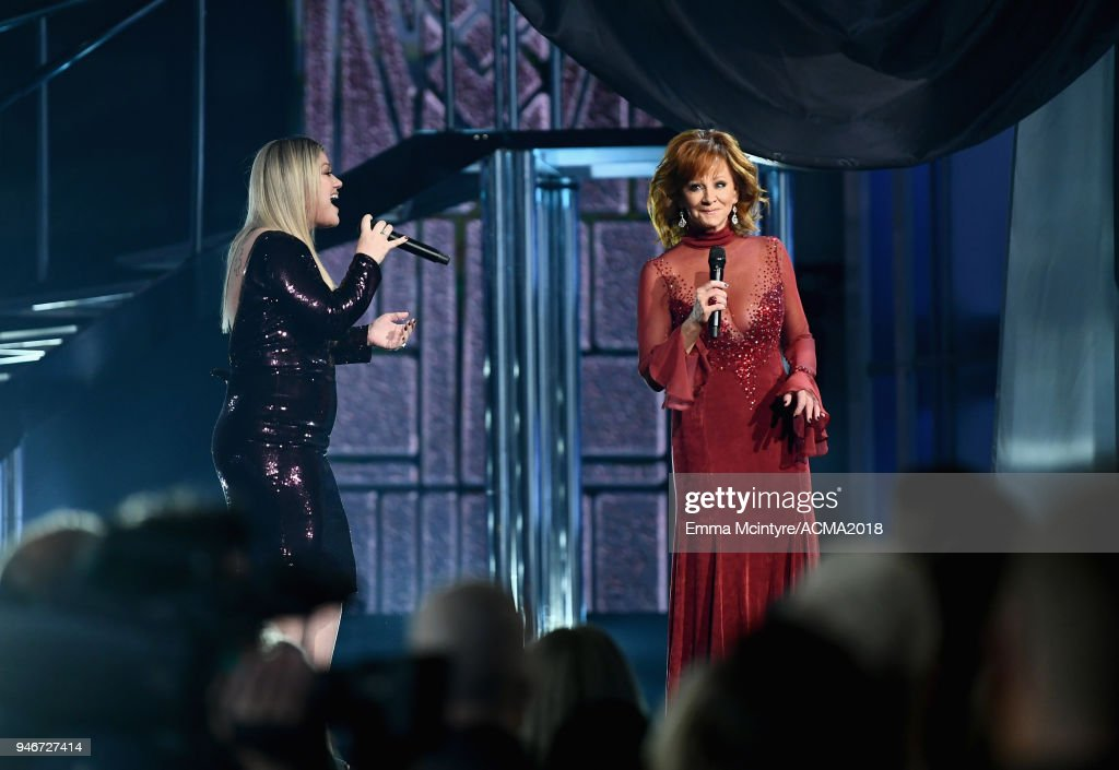 Kelly Clarkson (L) and Reba McEntire perform at the 53rd Academy of Country Music Awards at MGM Grand Garden Arena on April 15, 2018 in Las Vegas, Nevada.