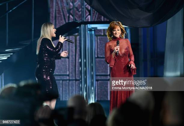 Kelly Clarkson and Reba McEntire perform at the 53rd Academy of Country Music Awards at MGM Grand Garden Arena on April 15 2018 in Las Vegas Nevada