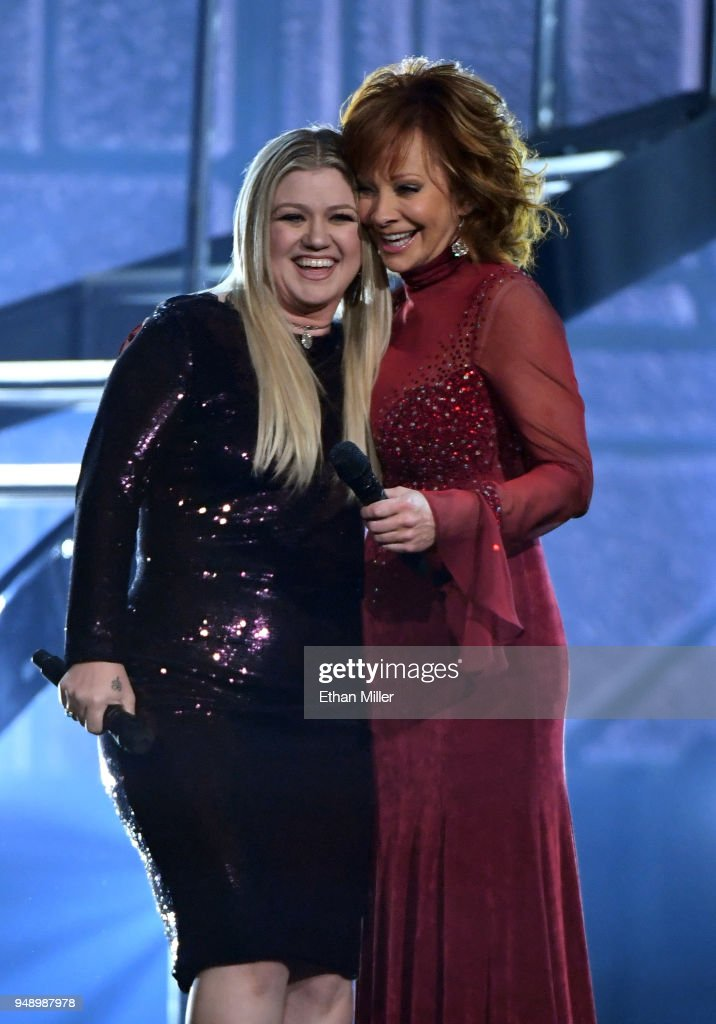 Kelly Clarkson (L) and Reba McEntire perform during the 53rd Academy of Country Music Awards at MGM Grand Garden Arena on April 15, 2018 in Las Vegas, Nevada.