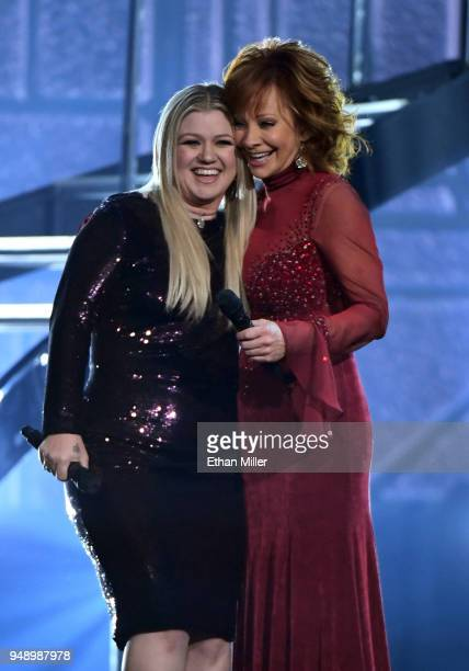 Kelly Clarkson and Reba McEntire perform during the 53rd Academy of Country Music Awards at MGM Grand Garden Arena on April 15 2018 in Las Vegas...