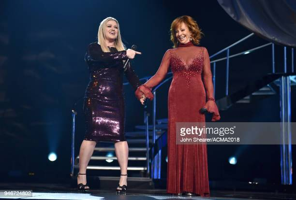 Kelly Clarkson and Reba McEntire perform onstage during the 53rd Academy of Country Music Awards at MGM Grand Garden Arena on April 15 2018 in Las...