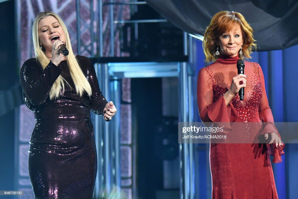 Kelly Clarkson (L) and Reba McEntire perform onstage during the 53rd Academy of Country Music Awards at MGM Grand Garden Arena on April 15, 2018 in Las Vegas, Nevada.