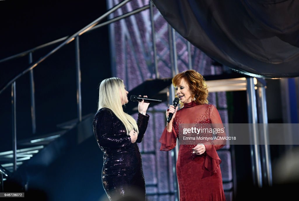 Kelly Clarkson and Reba McEntire perform onstage during the 53rd Academy of Country Music Awards at MGM Grand Garden Arena on April 15, 2018 in Las Vegas, Nevada.