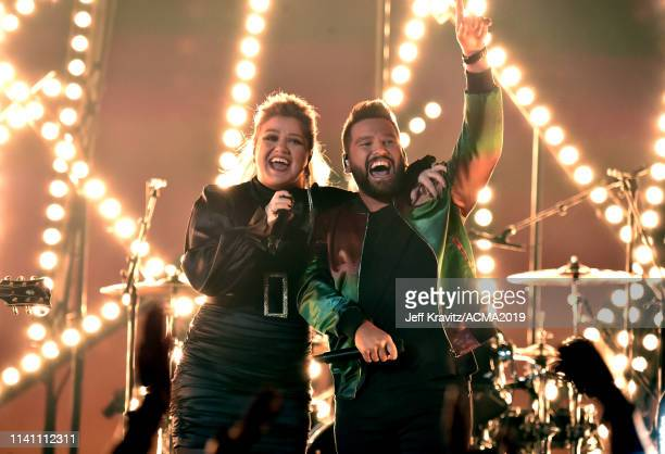 Kelly Clarkson and Shay Mooney perform onstage during the 54th Academy Of Country Music Awards at MGM Grand Garden Arena on April 07 2019 in Las...