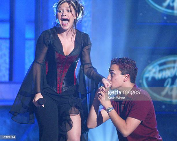 Kelly Clarkson is kissed by an audience member at FOX TV's American Idol broadcast live from Television City in Los Angeles Ca Tuesday July 16 2002...