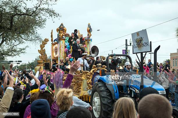 kelly clarkson leading mardi gras parade in new orleans - mardi gras parade stock photos and pictures