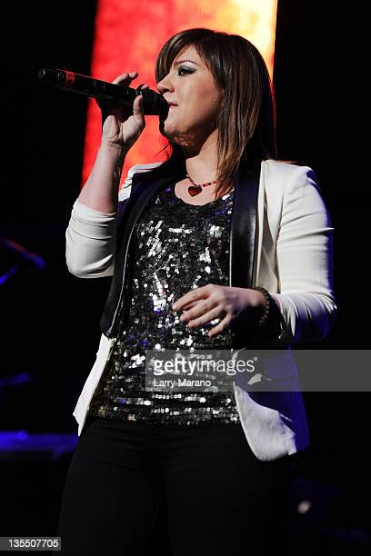 Kelly Clarkson performs at the Y 100 Jingle Ball at BankAtlantic Center on December 10 2011 in Sunrise Florida