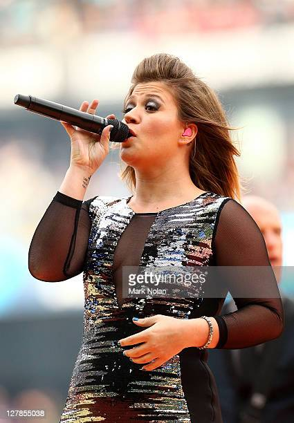 Kelly Clarkson performs before the 2011 NRL Grand Final match between the Manly Warringah Sea Eagles and the Warriors at ANZ Stadium on October 2...
