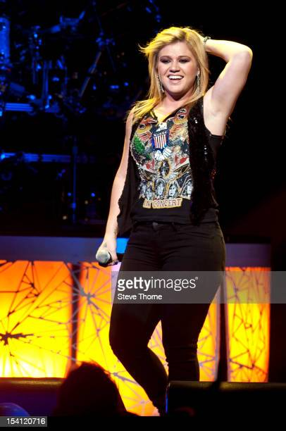 Kelly Clarkson performs on stage at LG Arena on October 14, 2012 in Birmingham, United Kingdom.