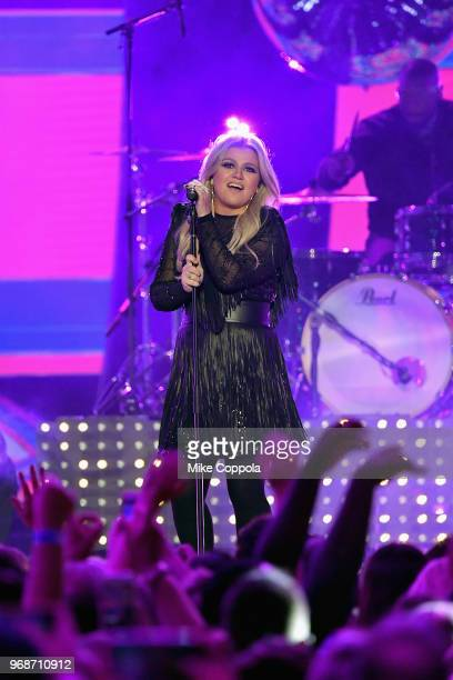 Kelly Clarkson performs onstage at the 2018 CMT Music Awards at Bridgestone Arena on June 6 2018 in Nashville Tennessee