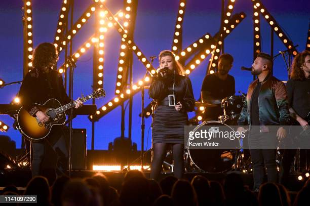 Kelly Clarkson performs with Dan Smyers and Shay Mooney of Dan + Shay onstage during the 54th Academy Of Country Music Awards at MGM Grand Garden...