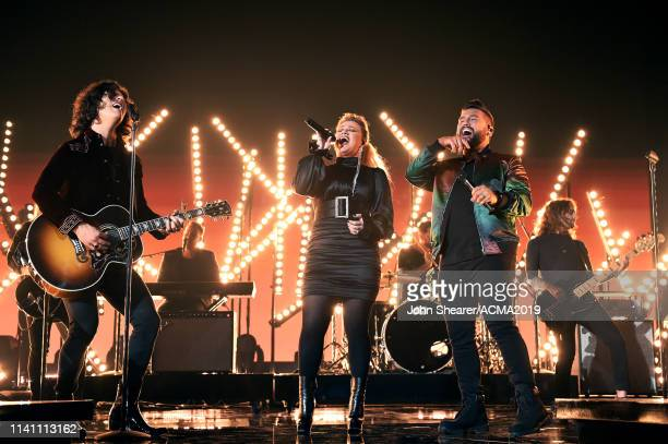 Kelly Clarkson performs with Dan Smyers and Shay Mooney of Dan Shay onstage during the 54th Academy Of Country Music Awards at MGM Grand Garden Arena...