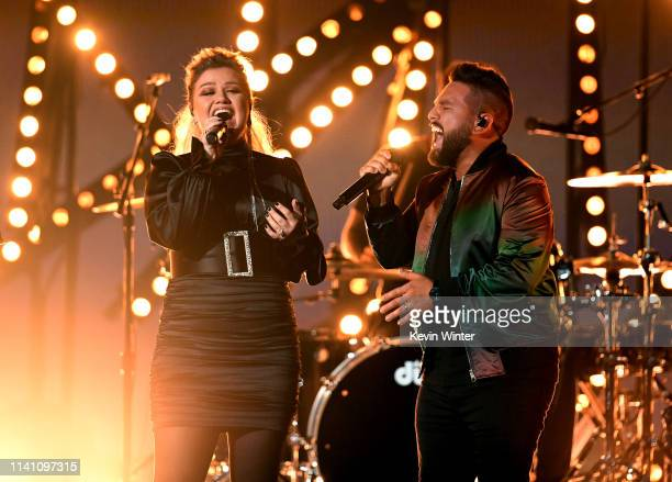 Kelly Clarkson performs with Shay Mooney of Dan Shay onstage during the 54th Academy Of Country Music Awards at MGM Grand Garden Arena on April 07...