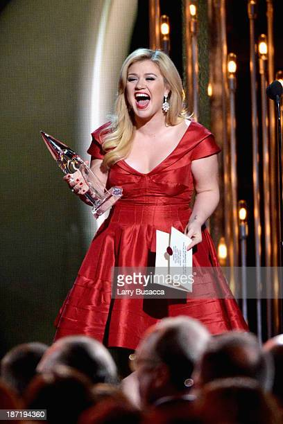 Kelly Clarkson presents Male Vocalist of the Year onstage during the 47th annual CMA awards at the Bridgestone Arena on November 6, 2013 in...