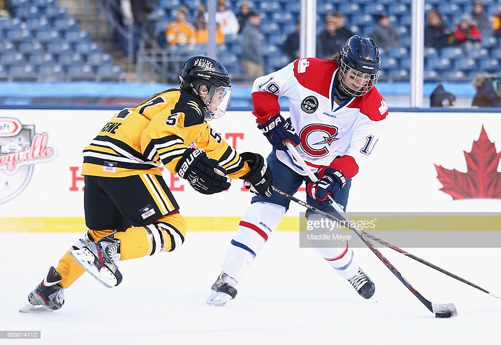 Kelly Cooke #5 of the Boston Pride (NWHL) defends against Katia Clement-Heydra #19 of the Les Canadiennes (CWHL) during the Outdoor Womens Classic at Gillette Stadium on December 31, 2015 in Foxboro, Massachusetts.