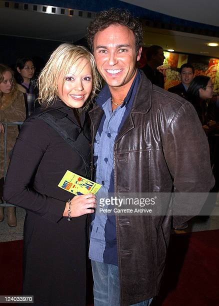 Kelly Crawford and Nathan Foley arrive for the Sydney premiere of the film 'Dirty Deeds' at Hoyts Cinema George Street on July 15 2002 in Sydney...