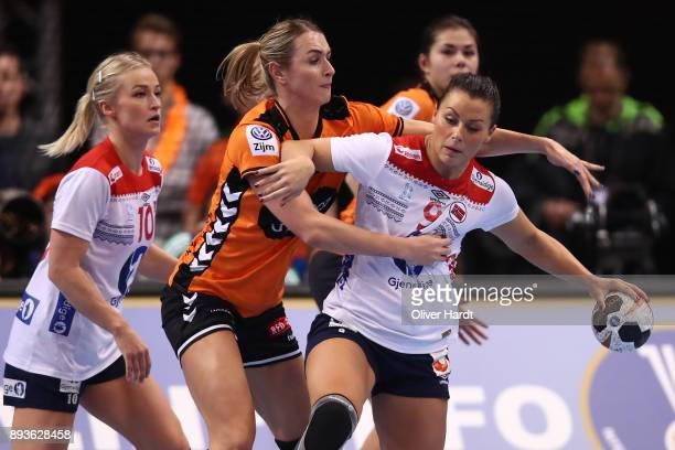 Kelly Dulfer of Netherlands and Nora Mork of Norway challenges for the ball during the Championship Semi Final between match between Netherlands and...
