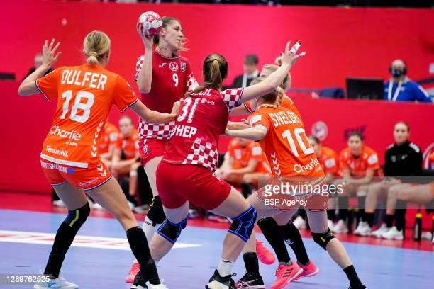 Kelly Dulfer of Netherlands, Camila Micijevic of Croatia, Ana Debelic of Croatia, Danick Snelder of Netherlands during the Women's EHF Euro 2020...