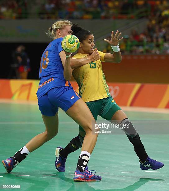 Kelly Dulfer of Netherlands holds Francielle Rocha of Brazil during he Womens Quarterfinal match between Brazil and Netherlands on Day 11 of the Rio...