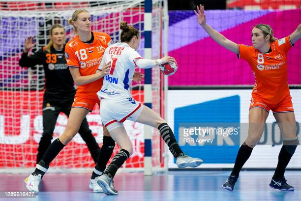 Kelly Dulfer of Netherlands, Marija Agbaba of Serbia, Lois Abbingh of Netherlands during the Women's EHF Euro 2020 match between Netherlands and...