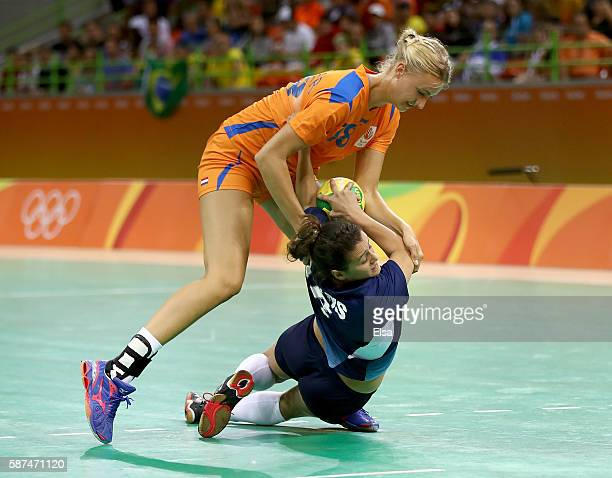 Kelly Dulfer of Netherlands shoves Macarena Sans of Argentina in the first half on Day 3 of the Rio 2016 Olympic Games at the Future Arena on August...