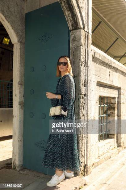 Kelly Eastwood poses with Mehry Mu bag during in Balat tour on November 02, 2019 in Istanbul, Turkey.