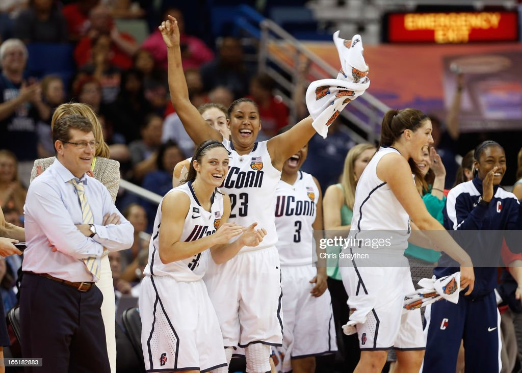 Kelly Faris #34, Kaleena Mosqueda-Lewis #23 and head coach Geno Auriemma of the Connecticut Huskies celebrate on the bench late in the game against the Louisville Cardinals during the 2013 NCAA Women's Final Four Championship at New Orleans Arena on April 9, 2013 in New Orleans, Louisiana.