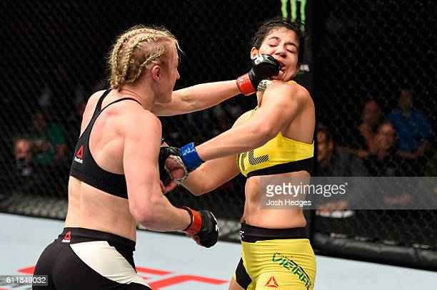Kelly Faszholz punches Ketlen Vieira of Brazil in their women's bantamweight bout during the UFC Fight Night event at the Moda Center on October 1...
