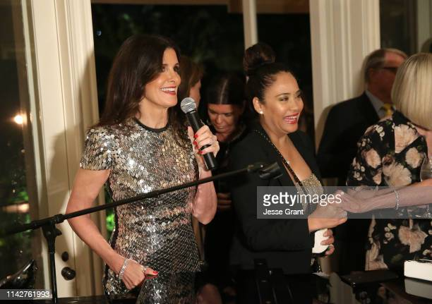 Kelly Fisher Katz speaks alongside Nicole Pantenburg during a private dinner for The Kennedy Center's National Committee For The Performing Arts on...