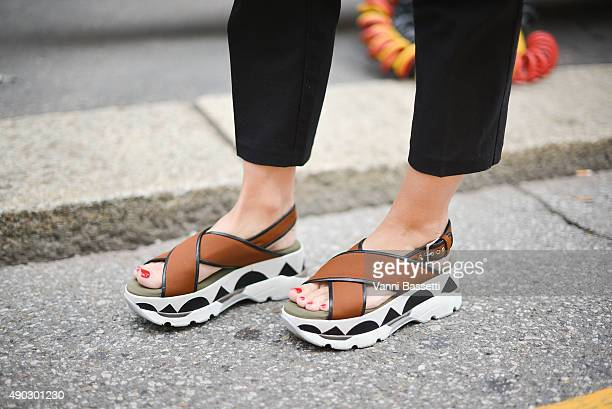 Kelly Flynn poses wearing Marni shoes before the Marni show during the Milan Fashion Week Spring/Summer 16 on September 27 2015 in Milan Italy