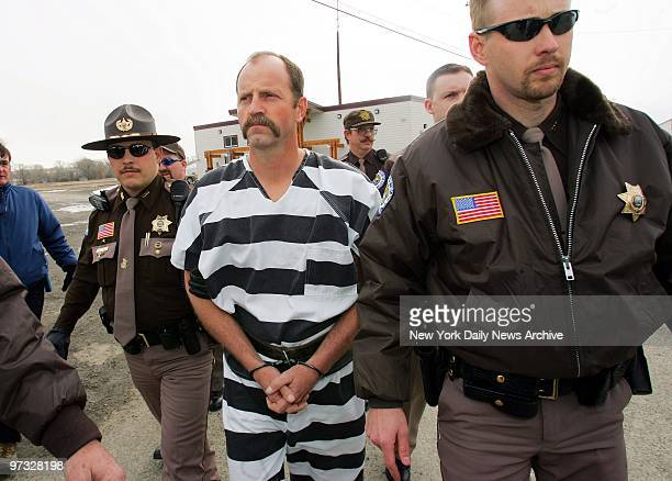 Kelly Frank is escorted from the Teton County Sheriff's Office to the County Courthouse for his arraignment Frank an excon who spent three years...