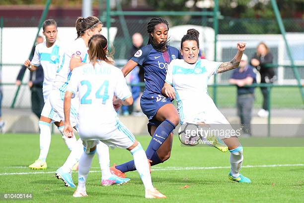 Kelly Gadea of Marseille clears under pressure from Marie Antoinette Katoto of PSG during the women's French D1 league match between PSG and...