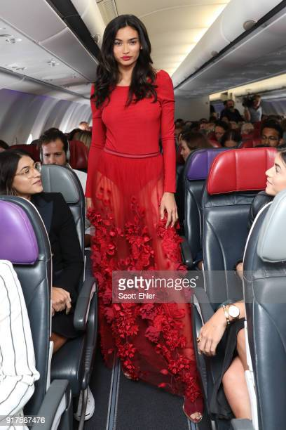 Kelly Gale showcases designs by Ginger Smart during Australia's first on board fashion show Virgin Australia Runway in the Sky on February 13 2018 in...