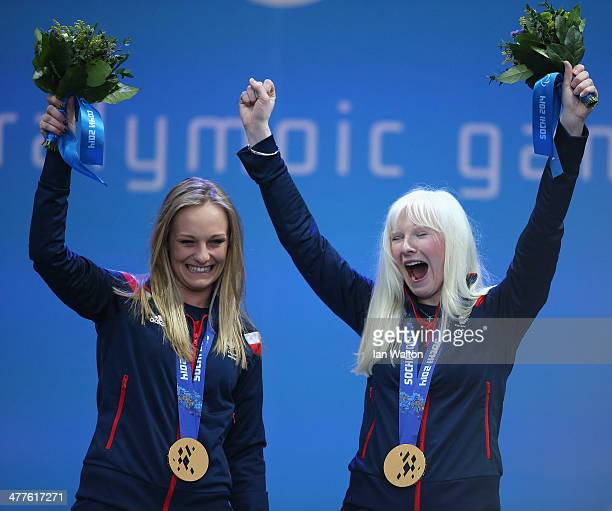 Kelly Gallagher of Great Britain and guide Charlotte Evans celebrate winning gold in the Women's Super-G - Visually Impaired during day three of...
