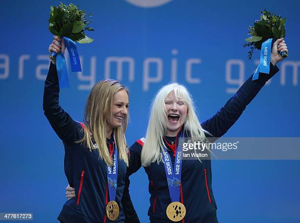 Kelly Gallagher of Great Britain and guide Charlotte Evans celebrate winning gold in the Women's SuperG Visually Impaired during day three of Sochi...